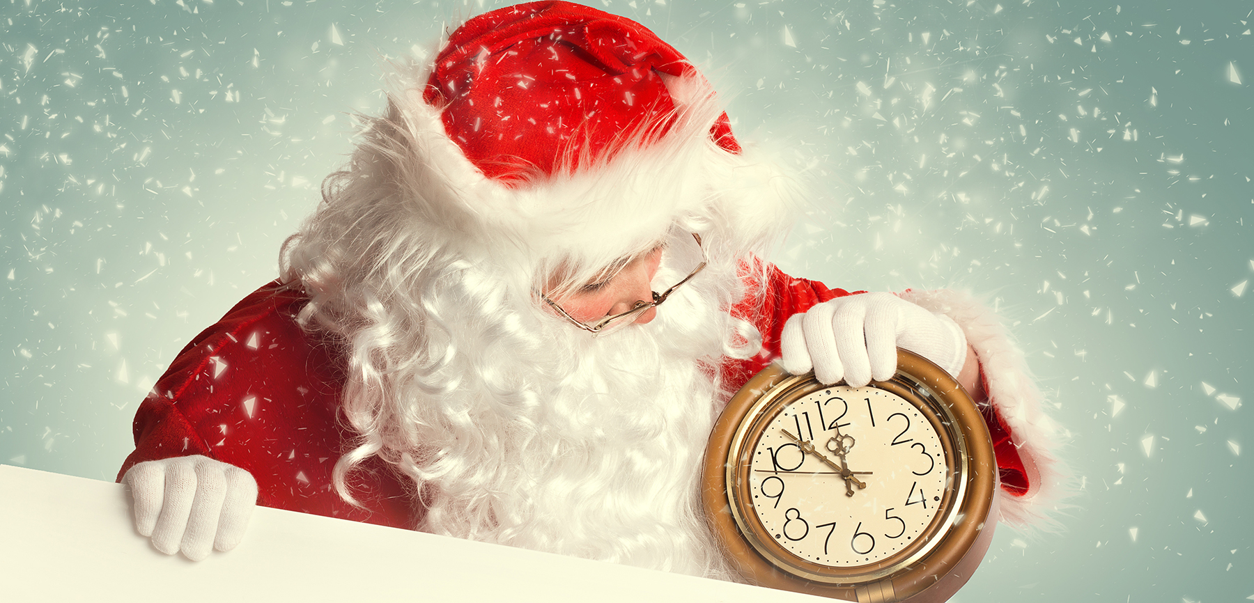 Santa Claus  with white blank banner holding a clock showing several  minutes to midnight